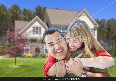 Mixed Race Couple Hugging in Front of House stock photo, Happy Affectionate Mixed Race Couple Hugging in Front of House. by Andy Dean