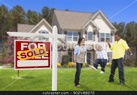 Hispanic Family in Front of Sold Real Estate Sign, House stock photo, Happy Hispanic Family in Front of Their New House and Sold Home For Sale Real Estate Sign. by Andy Dean