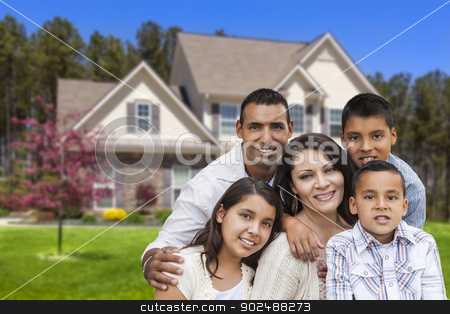 Hispanic Family in Front of Beautiful House stock photo, Happy Hispanic Family Portrait in Front of Beautiful House. by Andy Dean
