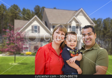 Mixed Race Young Family in Front of House stock photo, Happy Mixed Race Young Family in Front of Beautiful House. by Andy Dean