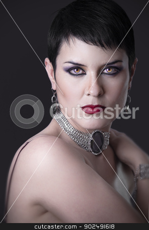 A portrait of a glamorous woman with jewelry on dark bacground   stock photo, A portrait of a glamorous woman with jewelry on dark bacground by Fernando Cortes