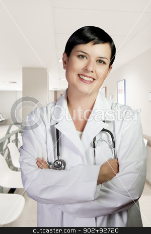 Woman with lab coat and stethoscope in a business environment  stock photo, Woman with lab coat and stethoscope in a business environment by Fernando Cortes
