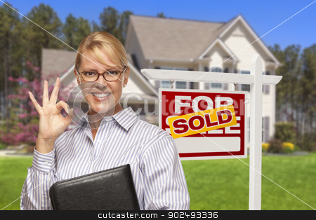 Real Estate Agent in Front of Sold Sign and House stock photo, Female Real Estate Agent in Front of Sold Home For Sale Sign and House. by Andy Dean
