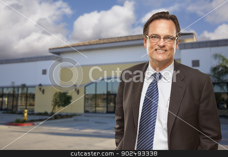 Businessman In Front of Vacant Office Building. stock photo, Handsome Bussinesman In Front of Vacant Office Building. by Andy Dean