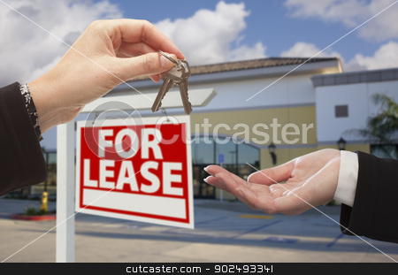 Handing Over Keys in Front of Business Office and Sign stock photo, Real Estate Agent Handing Over the Keys in Front of Vacant Business Office and For Lease Sign. by Andy Dean