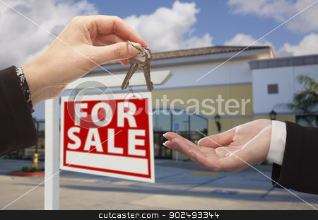 Agent Handing Over the Keys in Front of Business Office stock photo, Real Estate Agent Handing Over the Keys in Front of Vacant Business Office and For Sale Sign. by Andy Dean