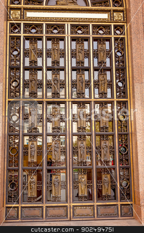 Metal Brass Door Entrance Doorway Professional Building Barcelon stock photo, Metal Brass Door Entrance Professional Building Doctors Lawyers Different Symbols Barcelona Catalonia Spain.  by William Perry