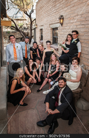Same Sex Wedding Group stock photo, Same sex wedding group sitting outside near brick wall by Scott Griessel