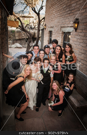 Same Sex Wedding Party stock photo, Group from a same sex wedding sitting outside near brick wall by Scott Griessel