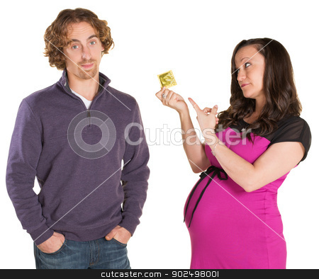 Expecting Parents with Condom stock photo, Frustrated man and pregnant woman pointing at condom by Scott Griessel