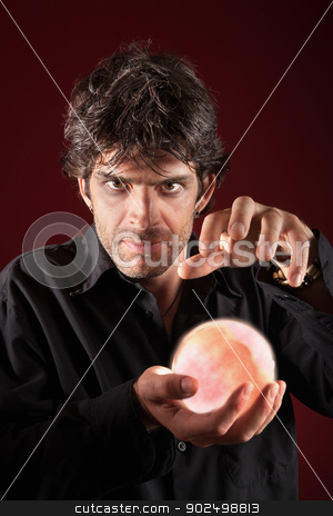 Soothsayer With Crystal Ball stock photo, Caucasian fortuneteller holds glowing crystal ball by Scott Griessel