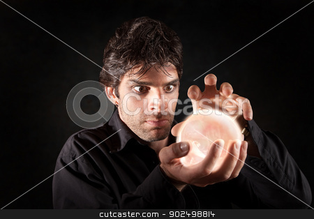 Man With Crystal Ball stock photo, Male fortune-teller gazes over a crystal ball by Scott Griessel