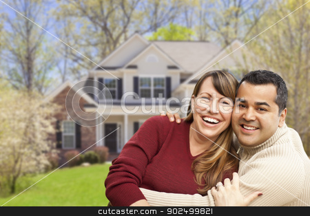 Happy Mixed Race Couple in Front of House stock photo, Happy Mixed Race Couple in Front of Beautiful House. by Andy Dean