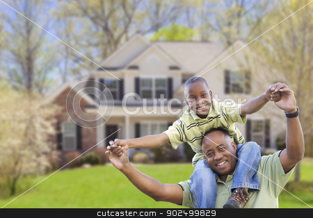 Playful African American Father and Son In Front of Home stock photo, Playful African American Father and Son In Front Yard of Home. by Andy Dean