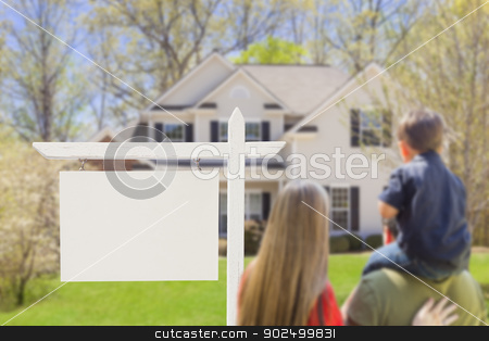 Family in Front of Blank Real Estate Sign and House stock photo, Mixed Race Young Family in Front of Blank Real Estate Sign and New House - Ready for Your Text. by Andy Dean