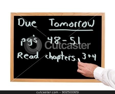 Homework stock photo, Tomorrow's homework is written in chalk on a blackboard. by Richard Nelson