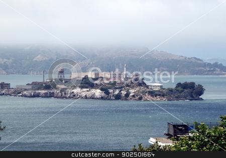 Alcatraz stock photo, The prison island Alcatraz with a fog bank over it. by Henrik Lehnerer