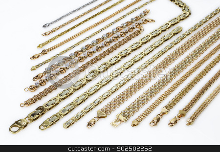 Gold jewelry stock photo, Gold chains and bracelets are parallel to the smoky white plastic by fogen