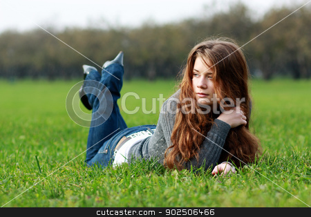 woman lying on a carpet of leaves in autumn park  stock photo, woman lying on a carpet of leaves in autumn park  by andersonrise