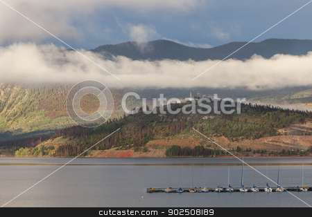 Lake Dillon in Colorado stock photo, Summer sunrise at Lake Dillon in Colorado Rocky Mountains with sailboats and visible forest damage by pine beetle by Marek Uliasz