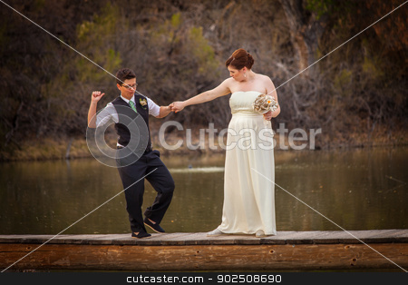 Smiling Cople Dancing Over Pond stock photo, Happy same sex couple dancing on dock over lake by Scott Griessel