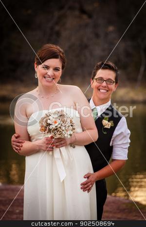 Couple Posing for Civil Union stock photo, Happy gay couple standing together for civil union by Scott Griessel