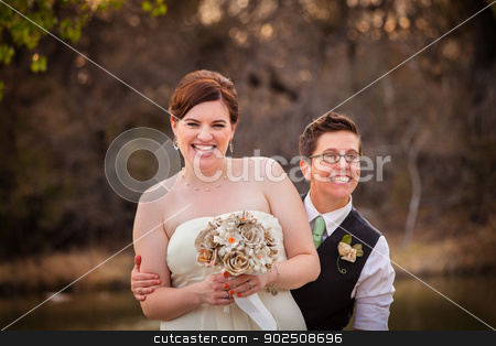 Gay Newlyweds Laughing stock photo, Cute newlywed gay couple laughing together by Scott Griessel
