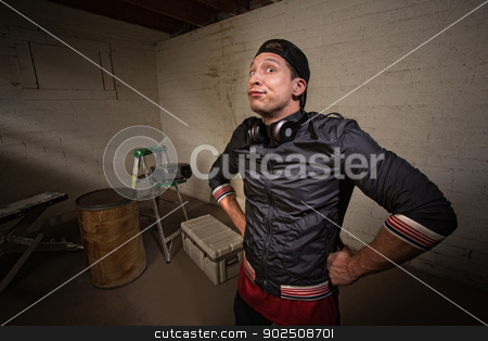 Frowning Hip Hop Poser stock photo, Frowning young European rapper with hands on hips by Scott Griessel