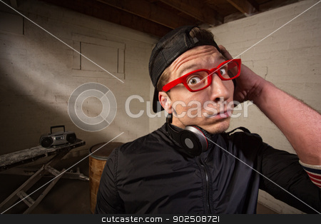 Startled European Man stock photo, Startled man with red eyeglasses and headphones by Scott Griessel