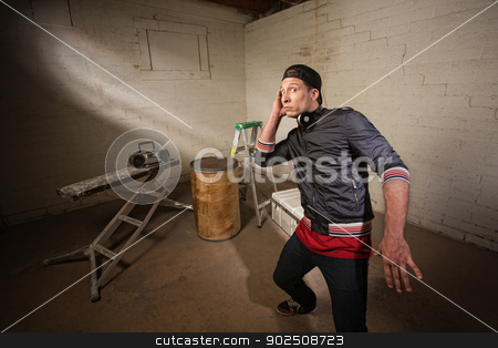 Man Listening to Radio stock photo, Interested urban musician leaning back near radio by Scott Griessel