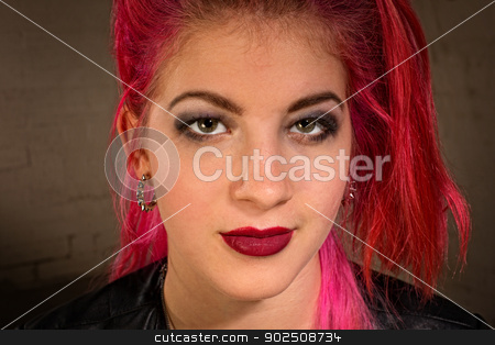 Confident Teenage Female stock photo, Confident young teen with pink and red hair by Scott Griessel