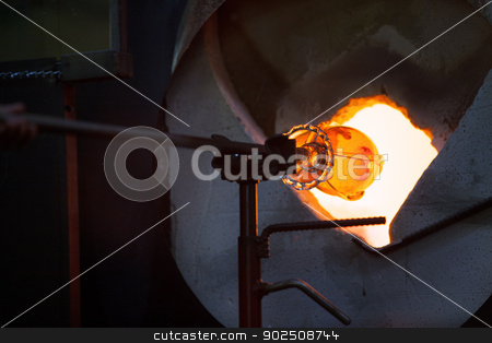 Glass in Blast Furnace stock photo, Close view of hot glass object in blast furnace by Scott Griessel