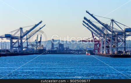 Seattle Washington Port with Red White Cranes and Freighters Shi stock photo, Seattle Washington Port with Red White Cranes Containers and Freighters Ships at Pier to Be Unloaded  by William Perry