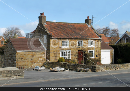 Cottage in countryside stock photo, Exterior of modern house or cottage in countryside, Burniston, England. by Martin Crowdy
