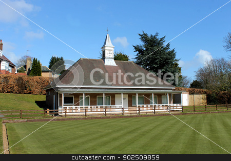 English bowling green and pavilion stock photo, Scenic view of English bowling green and pavilion with clock tower. by Martin Crowdy