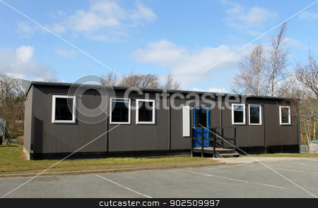 School mobile classroom stock photo, Exterior of mobile school classroom with blue sky and cloudscape background. by Martin Crowdy