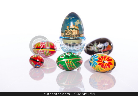 Painted easter eggs stock photo, Wooden painted ethnic easter eggs on white background by doupix