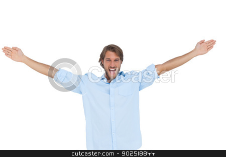 Handsome man shouting with his hands raised stock photo, Handsome man shouting with his hands raised on white background by Wavebreak Media