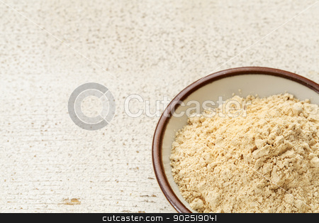 maca root powder  stock photo, maca root powder (nutrition supplement - superfood from Andies) in a small ceramic bowl on a rustic barn wood by Marek Uliasz