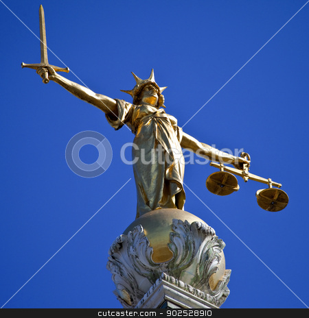 Lady Justice Statue ontop of the Old Bailey in London stock photo, The magnificent Lady Justice statue ontop of the Old Bailey (Central Criminal Court of England and Wales) in London. by Chris Dorney