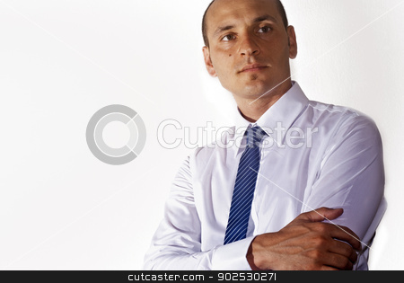 elegant businessman  stock photo, elegant businessman wearing suit looking up at camera isolated on white by Gandolfo Cannatella