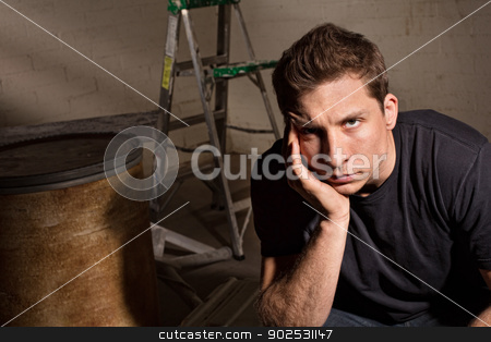 Upset Male Sitting stock photo, Upset adult male sitting with barrel and ladder by Scott Griessel