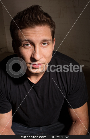 Easygoing Handsome Man stock photo, Easygoing white adult male in black shirt by Scott Griessel
