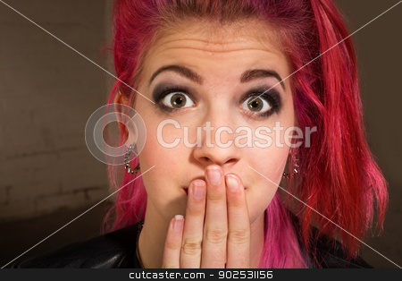 Young Woman in Suspense stock photo, Young punk rocker in pink hair with hand on mouth by Scott Griessel