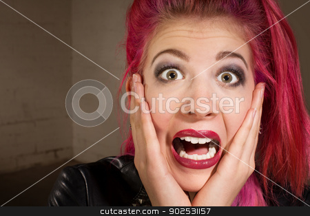 Scared Teen in Pink Hair stock photo, Horrified young punk rocker female in pink hair by Scott Griessel