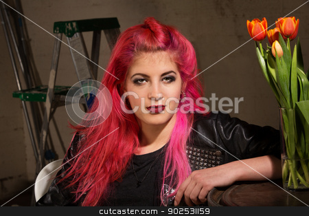 Calm Woman in Pink Hair stock photo, Calm woman in pink hairdo near ladder and tulips by Scott Griessel