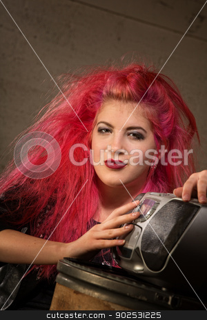 Cute Woman Listening to Radio stock photo, Pretty heavy metal music fan listening to radio by Scott Griessel