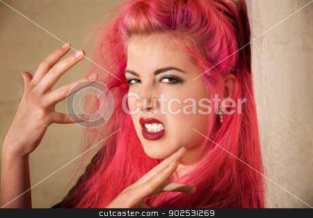 Emotional Punk Teen stock photo, Emotional young Caucasian punk woman gesturing with her hands by Scott Griessel