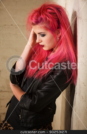 Depressed Woman Leaning Back stock photo, Depressed young woman with pink hair leaning against a wall by Scott Griessel