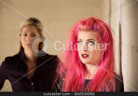 Annoyed Parent and Child stock photo, Annoyed girl in pink hair with upset parent by Scott Griessel